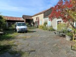 River stone house, 3 bedrooms, large outbuildings.