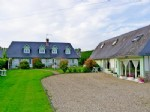 2 character Norman longere houses with beautiful gardens on the edge of a quiet village