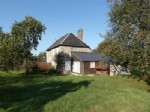Pretty family house located in the countryside. Short drive to village with shops.