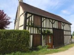 this beautifully maintained colombage cottage on a quiet country lane