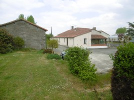Rural single storey residence with outbuildings