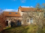 Pretty house with outbuildings in a quiet hamlet