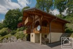 A spacious and modern, 4 bedroom chalet with large garden and views