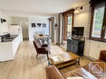 Tastefully renovated, furnished apartment with 56m2 south facing terrace, in a quiet location.