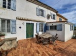 Charming village house to renovate with terrace with views, courtyard and garage.