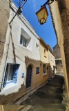 Pretty and renovated village house with a terrace and sold fully furnished.