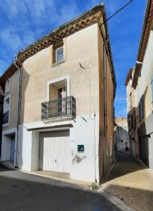 Renovated village house with 53 m² of living space including 2 bedrooms and a garage.