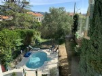 Townhouse garage, garden and swimming pool