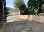 4-sided villa, garage, cellar and garden with views of the mountains.
