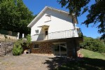 Family house located in the heart of nature overlooking the lot valley with panoramic views