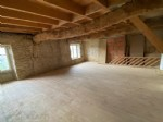 Set of 100m2 spread over 3 levels. on the ground floor, 36m2 room with fireplace and granite crocke