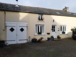 House with gite, garage, outbuilding and enclosed garden in village centre with shops nearby