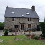 Renovated detached stone property with outbuilding and gardens.