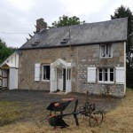 Normandy Stone Cottage with outbuildings set in one acre of land