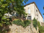 12th century domain with residence of 400 m², 4 gites and annexes, on a plot of 1 ha with pool.