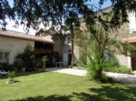 Lovely village house offering 210m² habitable + 160m² of outbuilding o