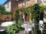 Renovated village house with 170 m² living space, studio, garage, garden and good income !